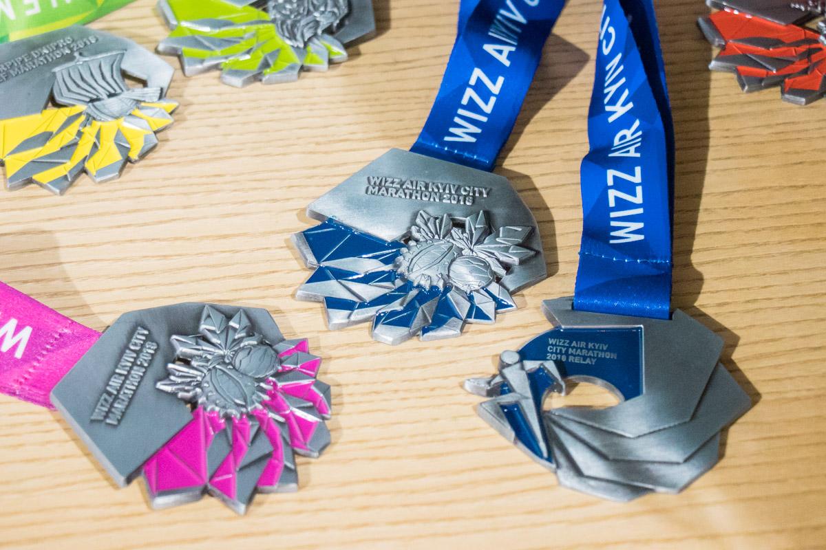 Дизайн медалей, которыми наградят бегунов